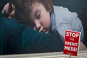 As Prime Minister Theresa May again meets opposition Labour leader Jreemy Corbyn in an attempt to break the deadlock in parliament of Brexit, a pro-EU protestor's placard and an showing a sleeping child opposite parliament in Westminster, on 4th April 2019, in London, England.