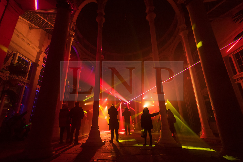 © Licensed to London News Pictures. 15/11/2019. LONDON, UK. Visitors view the light show in the Great Conservatory as The Enchanted Woodland opens on a rainy evening at Syon House in West London.  An illuminated trail takes visitors through gardens designed by Capability Brown, round an ornamental lake and ends at the spectacular Great Conservatory.  The show is open to the public 15 November to 1 December.  Photo credit: Stephen Chung/LNP