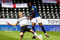 Louie Sibley of Derby County slides in to tackle Josh Dasilva of Brentford - Mandatory by-line: Ryan Crockett/JMP - 11/07/2020 - FOOTBALL - Pride Park Stadium - Derby, England - Derby County v Brentford - Sky Bet Championship