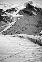 A group of skiers climb  toward the Col du Sonadon while touring the classic Haute Route in Switzerland.