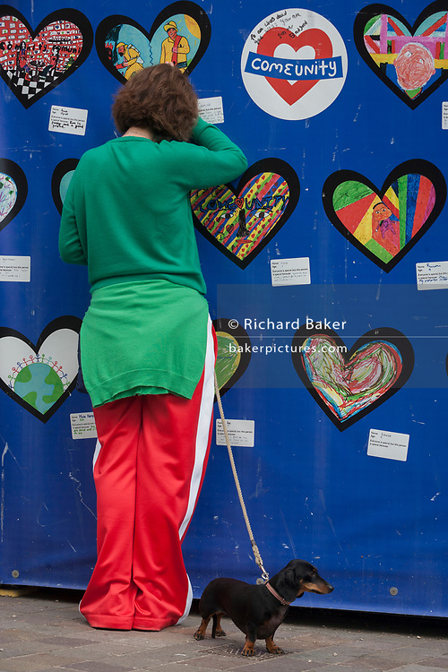 Emotional scenes on the first anniversary of the Grenfell tower block disaster where local schoolchildren have drawn pictures and messages, on 14th June 2018, in London, England. 72 people died when the tower block in the borough of Kensington & Chelsea were killed in what has been called the largest fire since WW2. The 24-storey Grenfell Tower block of public housing flats in North Kensington, West London, United Kingdom. It caused 72 deaths, out of the 293 people in the building, including 2 who escaped and died in hospital. Over 70 were injured and left traumatised. A 72-second national silence was held at midday, also observed across the country, including at government buildings, Parliament.
