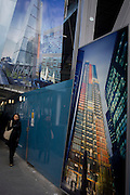 A Londoner walk beneath illustrations of future office development of the Leadenhall Building by the Brookfield Multiplex construction company at 100 Bishopsgate in the financial district City of London. Looking up to see the rise of the mammoth buildings already in use, the newest site grows upwards to occupy the empty location. The Brookfield Multiplex builds, engineers, develops and maintains property and infrastructure around the world. Over the past five decades we have successfully completed over 726 major projects, with a combined value of over $27.5 billion in Australasia, Europe, the Middle East and Asia. The 100 Bishopsgate development will become one of the most significant new commercial office buildings in the City comprising 3 buildings totalling c815,000sf NIA.