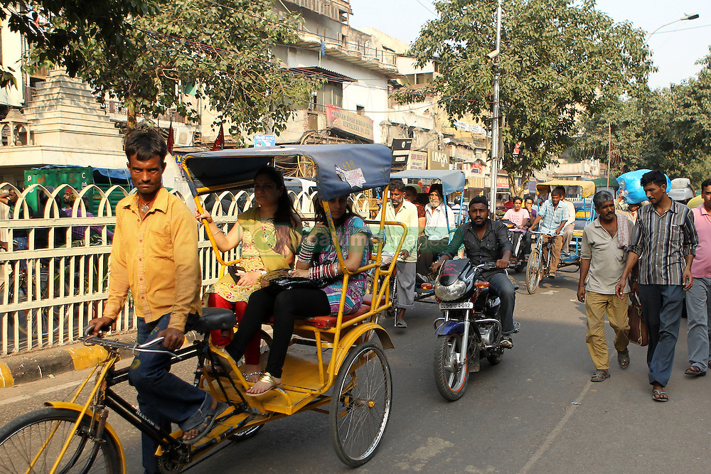 General street scene with pedal rickshaw in old Delhi in Delhi India.  The Commonwealth Games are being held in Delhi India between the 3rd and 14th October 2010..Photoby:  Ron Gaunt/SPORTZPICS