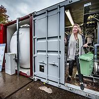 Nederland, Amsterdam, 4 november 2016.<br /> <br /> Lara van Druten is oprichter van The Waste Transformers. Dit bedrijf zet afval lokaal om in elektriciteit, warmte of groen gas. Via de Nederlandse ambassade kwam ze in contact met een belangrijke eerste klant in Durban, Zuid-Afrika.<br /> Het ministerie van Buitenlandse Zaken zet zich via de ambassades en RVO.nl in voor de belangen en kansen van het Nederlands bedrijfsleven in het buitenland.<br /> Op de foto: Managing director Lara van Druten  aan het werk bij de waste transformer in Westerpark.<br /> <br /> Netherlands, Amsterdam, November 4, 2016.<br /> In the heart of Amsterdam, the Netherlands, at the historic site of the Westergasfabriek, the installation of The Waste Transformers converts the organic waste from ten restaurants, two theaters, a micro-brewery and a number of creative industries. This former gas coal plant and the surrounding area has been transformed into a buzzing, healthy park.<br /> The collective organic waste from the Westerpark in Amsterdam is transformed into green energy, water and fertilizer that makes the park bloom even more. Residents around the park, and in the country, can take an energy subscription on the good vibes in the park. The Waste Transformers and partners ensure that this energy is 100% local and green.<br /> On the photo: Managing director Lara van Druten working at the waste transformer in the Westerpark in Amsterdam.<br /> <br /> Foto: Jean-Pierre Jans