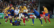 Valentin Ursache (Romania) making a break for it thorugh the French midfield during the Rugby World Cup Pool D match between France and Romania at the Queen Elizabeth II Olympic Park, London, United Kingdom on 23 September 2015. Photo by Matthew Redman.