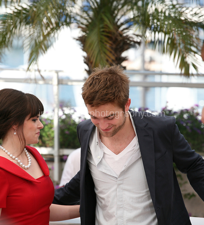 Emily Hampshire, Robert Pattinson at Cosmopolis photocall at the 65th Cannes Film Festival France. Cosmopolis is directed by David Cronenberg and based on the book by writer Don Dellilo.  Friday 25th May 2012 in Cannes Film Festival, France.
