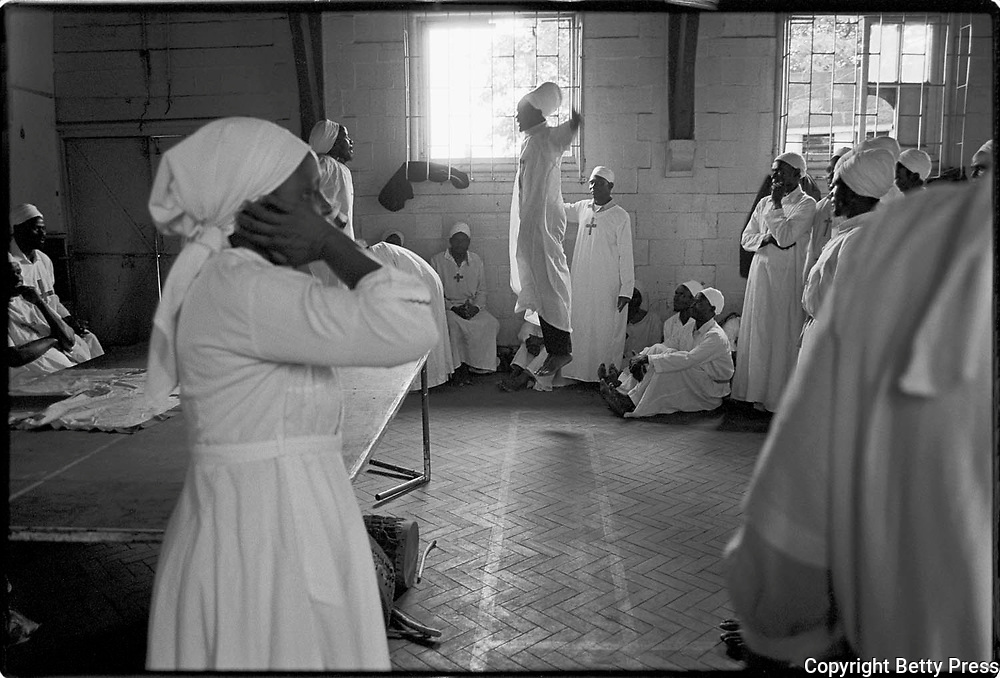 Religion bridges God and man. African proverb<br /> <br /> Many Africans have started their own churches, which feature a blend of Christianity and traditional religion.  This one was called The African Church of the Holy Spirit.  During the service there was ecstatic dancing, and talking in tongues. Members wear a uniform so people can easily identify them with their particular church. Nairobi, Kenya  1995