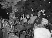 "Molly Malone Statue Unveiled. (R93)..1988..20.12.1988..12.20.1988..20th December 1988..""Dublin's Fair City"" received a millenniun gift to commemorate her most famous daughter, Molly Malone, when Jurys Hotel Group plc presented a specially commissioned sculpture to the people of Dublin. The sculpture was formally handed over by Michael McCarthy, MD,Jurys Hotel Group, to the Lord Mayor of Dublin, Councillor Ben Briscoe, TD, in an unveiling ceremony today at the corner of Grafton Street, Suffolk Street and Nassau Street..Molly Malone was created and fashioned in her traditional 17th century dress by Dublin born artist, Jeanne Rynhart, who was selected from a number of entries for the statue design, by the Dublin Millennium Board...In the shadow of the Christmas tree, Lord Mayor Ben Briscoe TD, Mr Michael McCarthy MD, Jurys Hotel Group and the artist Jeanne Rynhart are pictured waving for the cameramen at the official unveiling of ""Molly Malone""."
