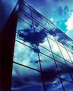 Clouds reflecting on a glass office building