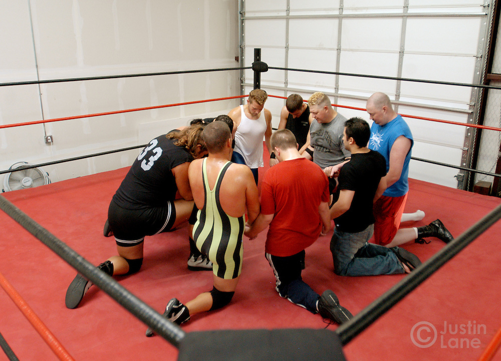 Members of the Christian Wrestling Federation join in prayer at the start of their regular practice in Rockwall, TX Monday, July 18, 2005. The group uses wrestling to minister to people who are interested in the sport but have not yet found Jesus. The group has been ministering since 2000.
