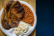 THOMPKINSVILLE, Ky. - Grilled pork shoulder with a side of baked beans and coleslaw at R&S Barbecue.