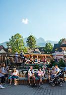 Zakopane, Poland - August 28, 2016: Pedestrians walk in the popular tourist town of Zakopane, located at the base of the Tatra Mountains in southern Poland.