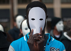 November 22, 2018 - Malaga, Spain - A man with a white mask is seen as he takes part in a flash mob organized by the humanitarian organization 'Caritas' to commemorates the International Homeless Day, which is celebrated on 27 november. (Credit Image: © Jesus Merida/SOPA Images via ZUMA Wire)