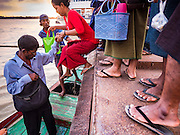 21 OCTOBER 2015 - YANGON, MYANMAR:   Passengers get into a cross river ferry at Botataung Pier, near Botataung Paya on the riverfront in Yangon. PHOTO BY JACK KURTZ