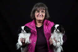 © Licensed to London News Pictures. 10/03/2016. Birmingham, UK. Sandra Mowatt with her japanese Chins named Dink and Cora at Crufts 2016 held at the NEC in Birmingham, West Midlands, UK. The world's largest dog show, Crufts is this year celebrating it's 125th anniversary. The annual event is organised and hosted by the Kennel Club and has been running since 1891. Photo credit : Ian Hinchliffe/LNP