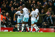 Dimitri Payet of West Ham United (l) celebrates with his teammates after scoring his teams 1st goal. Premier League match, Liverpool v West Ham Utd at the Anfield stadium in Liverpool, Merseyside on Sunday 11th December 2016.<br /> pic by Chris Stading, Andrew Orchard sports photography.