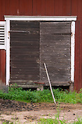 Traditional style Swedish wooden painted house. Black door. Barn Fading peeling painting. Smaland region. Sweden, Europe.