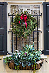 December 21, 2017 - Charleston, South Carolina, United States of America - A Christmas wreath hands from a window of a historic home on the Battery in Charleston, SC. (Credit Image: © Richard Ellis via ZUMA Wire)