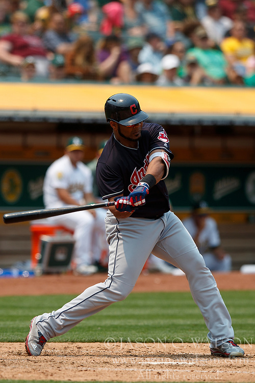 OAKLAND, CA - JULY 01: Edwin Encarnacion #10 of the Cleveland Indians at bat against the Oakland Athletics during the fifth inning at the Oakland Coliseum on July 1, 2018 in Oakland, California. The Cleveland Indians defeated the Oakland Athletics 15-3. (Photo by Jason O. Watson/Getty Images) *** Local Caption *** Edwin Encarnacion