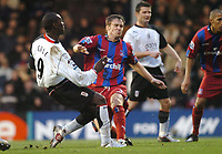 Andy Cole side foots the ball past Danny Granville to score thr 2nd goal for Fulham. Fulham v Crystal Palace, FA Barclaycard Premiership, 1/01/2005. Credit: Back Page Images / Matthew Impey