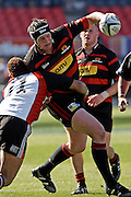 Canterbury flanker Hayden Hopgood tries to break free from the tackle of Counties Manukau wing Siale Piutau during the Air New Zealand Cup week 7 Ranfurly Shield match between Canterbury and Counties Manukau on Sunday September10, 2006 at Jade Stadium in Christchurch, New Zealand. Canterbury won the game 32-16. Photo: Jim Helsel/Photosport