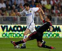Photo: Daniel Hambury.<br />Ajax v Inter Milan. Amsterdam Tournament. <br />04/08/2006.<br />Ajax's Thomas Vermaelen tackles Inter's Santiago Solari.