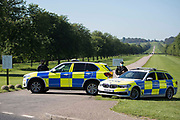 Thames Valley Police vehicles are parked across the Long Walk in Windsor Great Park as part of security arrangements for a dress rehearsal for Trooping the Colour at Windsor Castle on 9th June 2021 in Windsor, United Kingdom. A socially distanced and scaled down Trooping the Colour ceremony to mark the Queens birthday will take place at Windsor Castle on 12th June incorporating many of the elements from the annual ceremonial parade on Horse Guards, with F Company Scots Guards Trooping the Colour of the 2nd Battalion Scots Guards in the Castle Quadrangle.