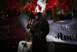 April 25, 2018 - Lisbon, Portugal - April 25, 2018 - Lisbon, Portugal - A woman with a red carnation (the symbol of the Portuguese revolution) hanging from her ear, shouts slogans, during a parade in Avenida da Liberdade, center Lisbon on the 44th anniversary of the Portuguese Carnation Revolution, on 25 April 1974. (Credit Image: © Pedro Nunes via ZUMA Wire)