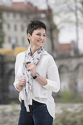 Mature woman holding her scarf and smiling, Bavaria, Germany