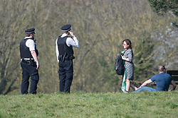 © Licensed to London News Pictures. 08/04/2020. London, UK. Police move members of the public lying down on Hampstead Heath, North London, during a pandemic outbreak of the Coronavirus COVID-19 disease. The public have been told they can only leave their homes when absolutely essential, in an attempt to fight the spread of coronavirus COVID-19 disease. Photo credit: Ben Cawthra/LNP