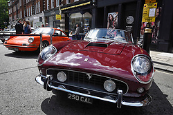 © Licensed to London News Pictures. 17/06/2018. LONDON, UK.(L to R) A 1970 Porsche 911 2.2S and a 1962 Ferrari 250SWB California Spyder at the 6th Annual Classic and Supercar Pageant held at St John's Wood High Street.  Traditionally taking place on Fathers' Day, the show brings together an eclectic mix of exotic and popular vehicles attracting visitors young and old and raises funds for the local charity, The St John's Hospice.  Photo credit: Stephen Chung/LNP