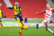 Matthew Lund of Scunthorpe United (7) takes a shot as Ali Crawford of Doncaster Rovers (11) tries to block it during the EFL Sky Bet League 1 match between Doncaster Rovers and Scunthorpe United at the Keepmoat Stadium, Doncaster, England on 15 December 2018.