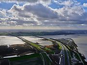 Nederland, Zuid-Holland, Dordrecht, 25-02-2020; Willemsdorp. Hollandsch Diep met Moerdijkbruggen. Twee spoorbruggen (een voor de HSL) en de autobrug voor de A16. Ingang tunnel HSL onder de Dordtsche Kil.<br /> Hollandsch Diep with Moerdijk bridges. Two railway bridges (one for the HSL) and the car bridge for the A16. Entrance tunnel HSL under the Dordtsche Kil.<br /> <br /> aerial photo (additional fee required)<br /> copyright © 2020 foto/photo Siebe Swart