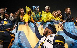 Sep 8, 2018; Morgantown, WV, USA; West Virginia Mountaineers fans celebrate with players after the game against the Youngstown State Penguins at Mountaineer Field at Milan Puskar Stadium. Mandatory Credit: Ben Queen-USA TODAY Sports