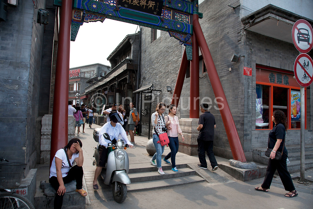 Entrance to Yandaixiejie Street (meaning Tobacco Pipe Lane) in Beijing, China. Located near to Houhai in downtown Beijing, Yandai Xiejie Street is a Hutong which attracts many tourists at day and night to it's souvenir shops and towards the bar area it leads to.