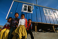 Inuit kids in front of their house, Scoresbysund, Ittoqottormiit, North East Greenland National Park, Greeenland, Arctic