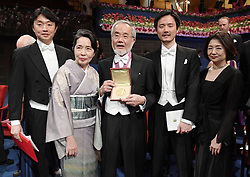 """Nobelpreisverleihung 2016 in der Konzerthalle in Stockholm / 101216 ***Nobel laureate Yoshinori Ohsumi (C) poses for photos, together with his wife Mariko (2nd from L), after attending an award ceremony in Stockholm on Dec. 10, 2016. Ohsumi was awarded the Nobel Prize in physiology or medicine for elucidating """"autophagy,"""" an intracellular process that degrades and recycles proteins."""