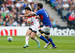Japan Inside Centre Harumichi Tatekawa is challenged by Samoa Lock Kane Thompson - Mandatory byline: Rogan Thomson/JMP - 07966 386802 - 03/10/2015 - RUGBY UNION - Stadium:mk - Milton Keynes, England - Samoa v Japan - Rugby World Cup 2015 Pool B.
