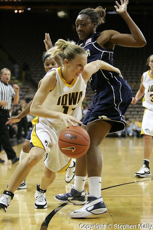 28 NOVEMBER 2007: Iowa guard Kristi Smith (11) tries to get by Georgia Tech forward Janie Mitchell (21) in the first half of Georgia Tech's 76-57 win over Iowa in the Big Ten/ACC Challenge at Carver-Hawkeye Arena in Iowa City, Iowa on November 28, 2007.