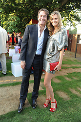 TIM & MALIN JEFFERIES at the annual Serpentine Gallery Summer party this year sponsored by Jaguar held at the Serpentine Gallery, Kensington Gardens, London on 8th July 2010.  2010 marks the 40th anniversary of the Serpentine Gallery and the 10th Pavilion.