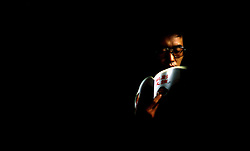 A man passes time reading on the overnight train from Beijing to Tianjin, China. (Photo © Jock Fistick)