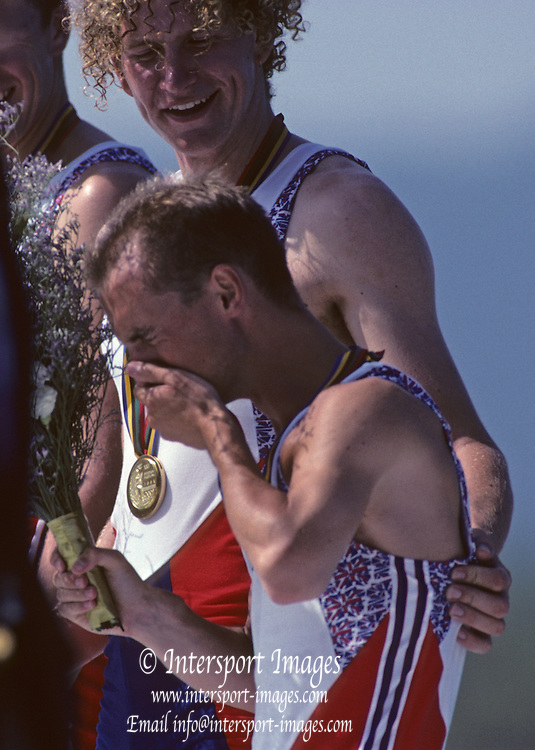 Barcelona, SPAIN. Gold Medalist, GBR M2+, Bow Jonny SEARLE and Greg SEARLE with an emotional cox, Gary HERBERT.  Celebrate on the awards dock. 1992 Olympic Rowing Regatta Lake Banyoles, Catalonia [Mandatory Credit Peter Spurrier/ Intersport Images] Last time Men's coxed pair raced at the Olympics
