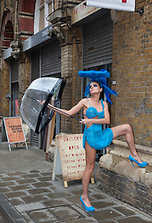 © licensed to London News Pictures. Bermondsey, London, UK  08/06/2011. 19 models wearing turquoise dresses by fashion designer Pierre Garroudi setting out on a flashmob in Bermondsey, London. Please see special instructions for usage rates. Photo credit should read Bettina Strenske/LNP