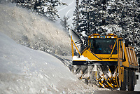 The Wyoming Department of Transportation's rotary snowblower makes its way to the top of Teton Pass on Wednesday morning. The contraption moves very slowly and the operation to clear snow from the shoulder of Highway 22 over the pass can take several hours.