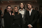 Joseph Andre, Lucy Andre, Gustave Andre, and Thaddeus Andre. Party to launch High Tide Writers Festival which will be held in Halesworth, Suffolk. Adam St. Club. 10 January 2007.  -DO NOT ARCHIVE-© Copyright Photograph by Dafydd Jones. 248 Clapham Rd. London SW9 0PZ. Tel 0207 820 0771. www.dafjones.com.