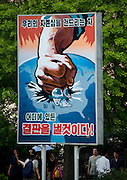 """Americans seen by North Korean's<br /> <br /> The USA is the arch nemesis of North Korea, but Americans can still visit the country. According to the Juche Travel, the North Korean travel agency, """"American tourists are permitted to visit the DPRK however they can only enter or exit the country by plane (not train), and cannot spend more than 10 days in the country.""""<br />  I met many American tourists during my 6 trips, and most of them were surprised as they were well welcomed by the guides and locals alike. It was a far cry from the aggressive propaganda and menacing official statements issued by the regime. The Americans were allowed to go everywhere except the homestays in the Chilbo area where tourists sleep in [carefully selected] local farmers' seaside homes. There was no explanation given, just an """"It is not possible"""".<br />  North Koreans are quick to employ images and symbols of America in their own propaganda. During the Cold War, they seized the American spy boat, the USS Pueblo. It is now a Pyongyang tourist attraction. The guide on the boat explains that the US soldiers wrote letters of apology since they were so ashamed of what they did to North Korea. After Bill Clinton went to North Korea to seek the release of American journalists Laura Ling and Euna Lee who were arrested by the North Koreans while researching human-trafficking, a director made a movie with the tv footages.<br /> In the giant """"Gifts Museum"""" that displays all the gifts the Dear Leaders received from all around the world (mainly from communist countries), the guides are proud to point out Secretary of State Madeleine Albright's gift to Kim Jong-Il: a basketball autographed by Michael Jordan. No photo allowed!<br />  Most of the propaganda posters depicting North Korea's hatred of the USA has been removed from the streets. Photographing the only such billboard I saw during my stay in Pyongyang was not easy as the guides always found an excuse not to stop the bus. """"Too much traffic,"""" t"""