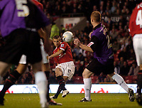 Photo: Jed Wee.<br />Manchester Utd v Barnet. Carling Cup. 26/10/2005.<br /><br />Manchester United's Liam Miller scores from the resultant freekick to add insult to injury.