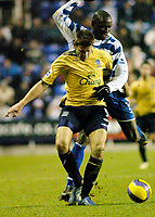 Photo: Gareth Davies.<br /> Reading v Everton. The Barclays Premiership. 23/12/2006.<br /> Reading's Ibrahima Sonko (R) out muscles Everton's James Beattie (L) for the ball.