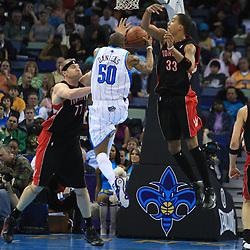 06 February 2009:  New Orleans Hornets guard Antonio Daniels (50) drives between Toronto Raptors defenders Jamario Moon (33) and Jake Voskuhl (77)during a NBA game between the New Orleans Hornets and the Toronto Raptors at the New Orleans Arena in New Orleans, LA.