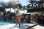 O DANCE COMPANY PERFORMANCE IN POOL, Sagamore Hotel Art Basel brunch.   Miami Beach. 4 December 2010. -DO NOT ARCHIVE-© Copyright Photograph by Dafydd Jones. 248 Clapham Rd. London SW9 0PZ. Tel 0207 820 0771. www.dafjones.com.